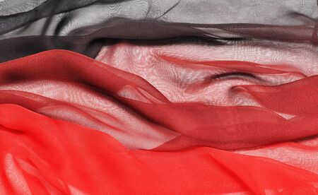chiffon: Abstract black-red soft chiffon texture background.Macro with extremely shallow dof.