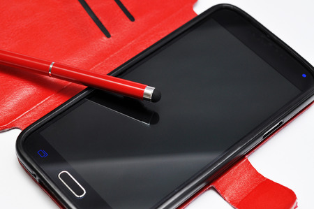 Stylus pen on a smartphone. Macro with extremely shallow dof. Technology mobile.