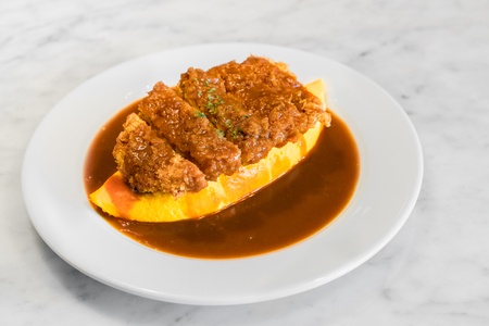 an omelette: Demiglace sauce omurice with pork cutlet or tonkatsu. Omelette rice,omurice, Japanese food