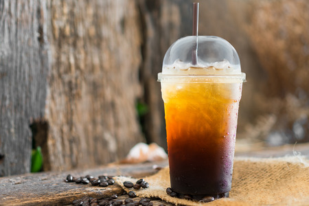 coffee, Iced Americano black coffee on a wooden table