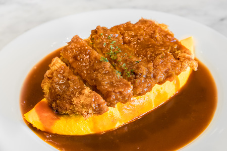 Demiglace sauce omurice with pork cutlet or tonkatsu. Omelette rice,omurice, Japanese food