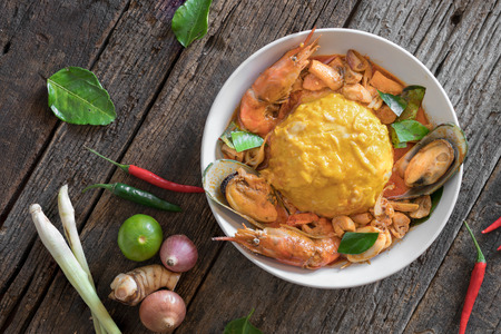 goong: Tom Yam Goong or Spicy Shrimp Soup , Rice and scrambled eggs topped with Tom Yum Seafood sauce, omurice, omelette rice