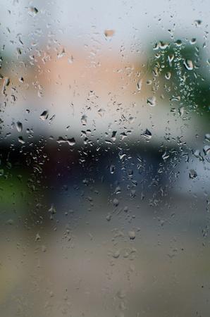 precipitate: Rain on the window glass