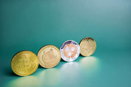 Bitcoin, Ripple XRP, Dogecoin, Ethereum cryptocurrency on green background