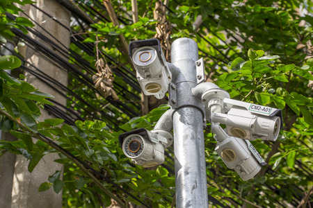 under surveillance: Multiple Angle Outdoor CCTV Camera on the Pole