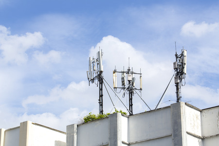 resident: Cell Phone Tower on Resident Building Roof with Blue Sky