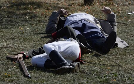 Soldiers depicting those killed in a costume reconstruction of the Battle of Borodino.