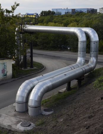 Metal pipes pass over the road.