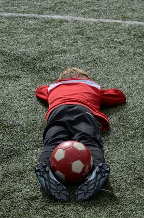 The goalkeeper is resting before the match.