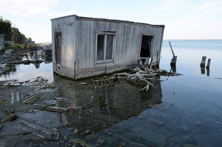 Sunken house on the lake.