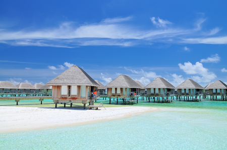 maldivian: Maldivian water bungalows with blue sky and sea.