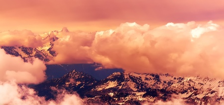 swiss alps: Beautiful Swiss Alps surrounded by floating clouds. Stock Photo