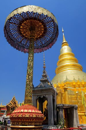 hariphunchai: Wat Phra That Hariphunchai, one of the most famous temple in Lamphun, Thailand. The Holy Relics are contained inside the golden pagoda. Stock Photo
