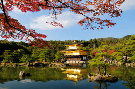 two floors: Fall foliage at Kinkaku-ji temple in Kyoto, Japan. Kinkaku-ji literally means Temple of the Golden Pavilion. This temple is a Zen temple in northern Kyoto whose top two floors are completely covered in gold leaf and it is one of 17 locations comprising th Editorial