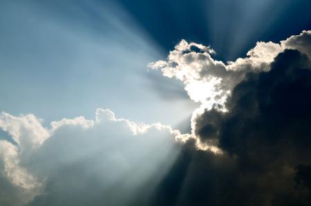 Beautiful sunbeam through the black stormy cloud.