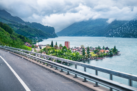 Stunning view of the town near the Walensee lake taken on a rainy day during the road trip on the A3 highway in Quarten, St.Gallen, Switzerland. Stock Photo