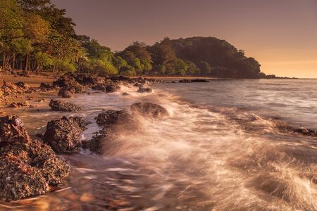 Stunning golden hour of sunrise at Rayong Beach in Rayong province, Thailand.  Фото со стока