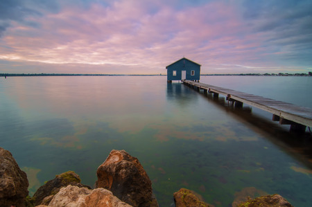 perth: Western Australia - Sunrise View of Perth Skyline from Swan River with boatshed as a foreground