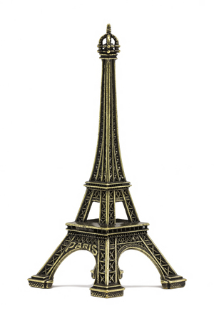 The Eiffel tower souvenir, on a white background photo