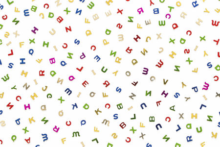 jumbled: Many letters of various colors mixed