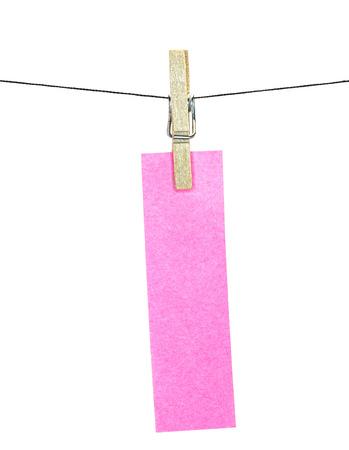 Flat pink rectangular sticky note hanged, isolated on white background photo