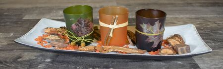 Autumn decoration, candle holder on wooden bowl Stock Photo