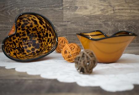 Table decoration, 2 patterned bowls with wooden balls Reklamní fotografie