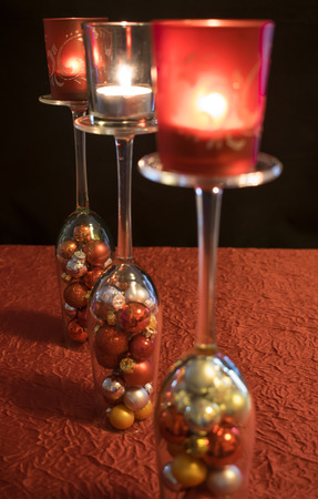 upturned: Christmas, upturned glasses with Christmas balls and candle