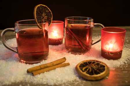 Mulled wine in the snow with candle light