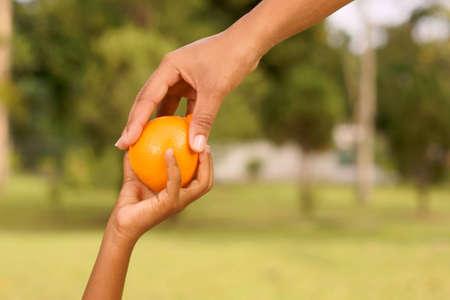 handing tangerine photo