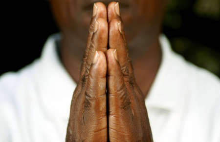 prayer: fingers of afro man in prayer