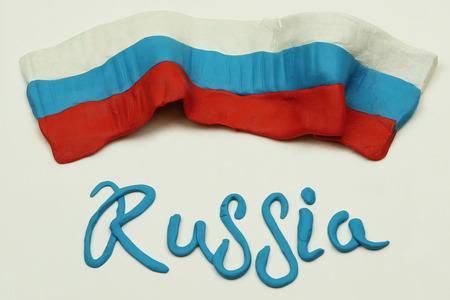 Plasticine flag of Russia. plasticine letters Russia 免版税图像