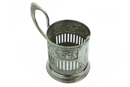 Russian metal cup holder. Vintage cup holder on a white background.