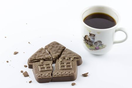 Chocolate house and a Cup of coffee. Figures made of chocolate, Delicious dessert. Confectionery A restaurant Stock Photo