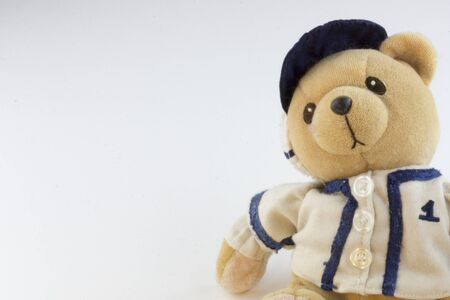 Teddy bear athlete in a baseball cap - toy. template for your postcard design, greetings, ads.