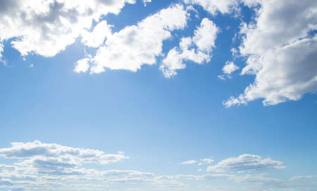 Beautiful blue-sky. Cloudscape Divine. Blue sky with white clouds, hot summer day. Angelic Heavens.