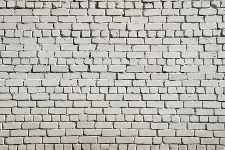 White brick wall background. A brick wall of rough white brick. Brutal abstract grunge background.
