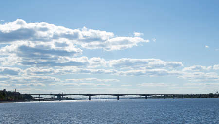 River and sky with cloud. Summer landscape with a view of the wide river. City embankment, view of the other Bank. 写真素材