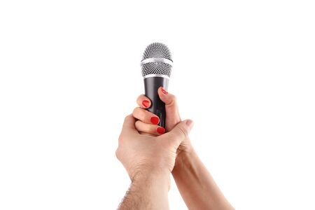 Woman hand holding a microphone, isolated on white background