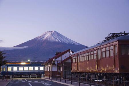 crater highlands: Mt Fuji at dawn and the Train Station. Train Station and Mt Fuji in the background at dawn.