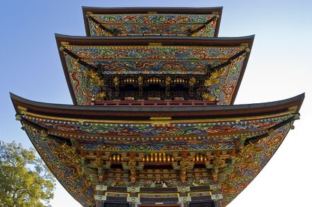 Pagoda, buddhist temple  in Narita-san. The painted colorful flowers and the gold, embellish this big eastern architecture.