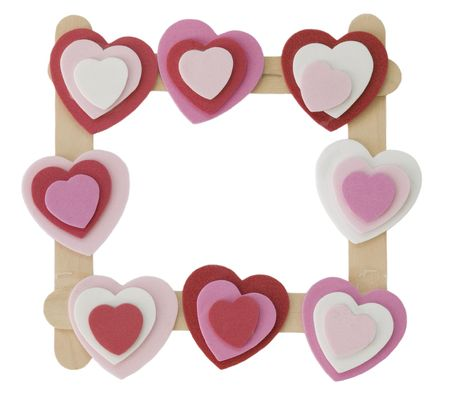 Wood frame with hearts isolated on white.