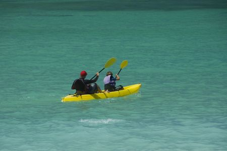 Father and son kayaking in the blue waters of Hawaii. Kailua,Oahu,Hawaii.