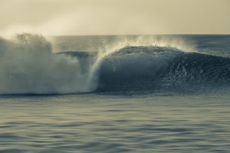 Perfect wave breaking on the shore. Pipeline in the North Shore of Oahu, Hawaii. Split tone. Stock Photo