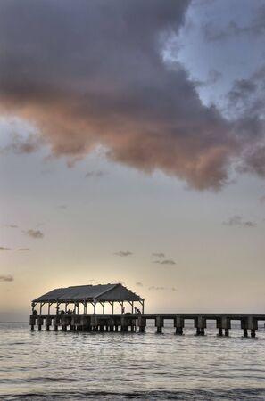 Vertical view of Pier at Hanalei Bay  Beach in Kauai during sunset. HDR. Stock fotó