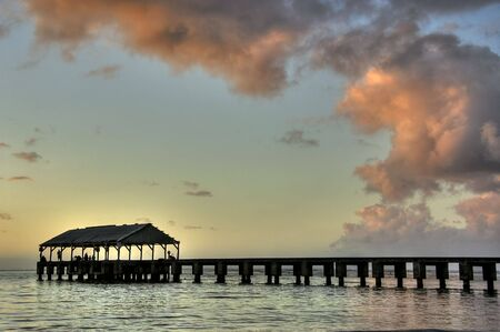 View of Pier at Hanalei Bay  Beach in Kauai during sunset. HDR.