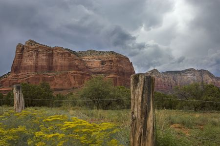 Sedonas red rock formation and storm.