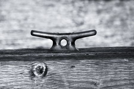 cleat: Black and White Boat Cleat at the dock. Stock Photo