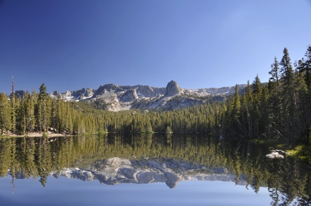 Mammoth Lakes in California. Lake Mamie showing the reflections of the mountain range in Sierra Nevada. Stock Photo
