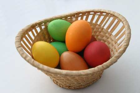 Basket with easter eggs on a white background